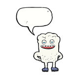 Cartoon tooth looking smug with speech bubble Stock Photography
