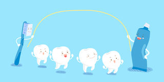 Cartoon tooth play happily Stock Images