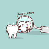 Cartoon tooth take a picture Stock Photo