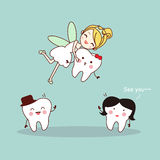 Cartoon tooth with tooth fairy Stock Images