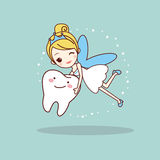 Cartoon  tooth with tooth fairy. Great for dental care concept Stock Photo