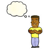 Cartoon tough guy with folded arms with thought bubble Royalty Free Stock Image