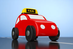 Cartoon Toy Car with Taxi Sign Royalty Free Stock Photo