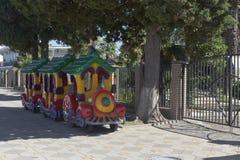 Cartoon train for children on the waterfront near amusement park in the settlement of Adler, Sochi, Krasnodar region, Russia Royalty Free Stock Images