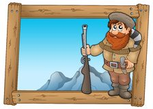Cartoon trapper in wooden frame Royalty Free Stock Images