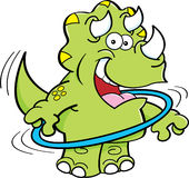 Cartoon triceratops playing with a hoop. royalty free illustration
