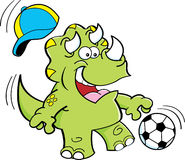 Cartoon triceratops playing soccer Royalty Free Stock Photo