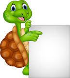 Cartoon turtle holding blank sign Royalty Free Stock Image