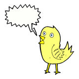 Cartoon tweeting bird with speech bubble Royalty Free Stock Image