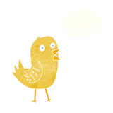 Cartoon tweeting bird with thought bubble Royalty Free Stock Photo