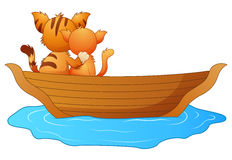 Cartoon two cats in a boat. Illustration of Cartoon two cats in a boat Royalty Free Stock Photography