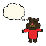 cartoon unhappy black bear  with thought bubble Stock Images