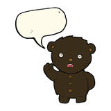 cartoon unhappy black teddy bear with speech bubble Stock Images