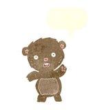Cartoon unhappy teddy bear with speech bubble Stock Photos