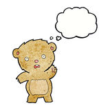 Cartoon unhappy teddy bear with thought bubble Stock Photography