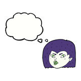 Cartoon vampire face with thought bubble Royalty Free Stock Photo