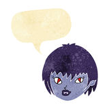 cartoon vampire girl face with speech bubble Stock Images