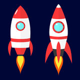 Cartoon vector red rockets on dark blue background. Flat spaceship Royalty Free Stock Image