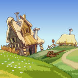 Cartoon village houses. With a thatched roof in the summer Royalty Free Stock Photos