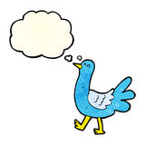 Cartoon walking bird with thought bubble Royalty Free Stock Image