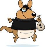 Cartoon Wallaby Burglar. A cartoon illustration of a wallaby burglar stealing money Stock Photo