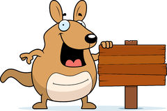Cartoon Wallaby Sign. A cartoon wallaby with a wooden sign Stock Photo