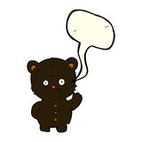 Cartoon waving black bear cub with speech bubble Stock Images