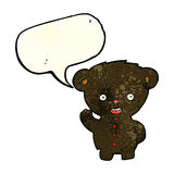 Cartoon waving black bear cub with speech bubble Royalty Free Stock Photography