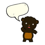 Cartoon waving black bear cub with speech bubble Stock Photos