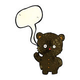 Cartoon waving black bear cub with speech bubble Royalty Free Stock Photo