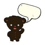 Cartoon waving black bear cub with speech bubble Stock Image