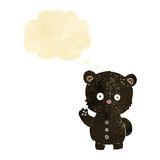 Cartoon waving black bear cub with thought bubble Stock Images