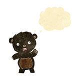 Cartoon waving black bear cub with thought bubble Royalty Free Stock Photo