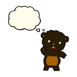 Cartoon waving black bear cub with thought bubble Stock Image