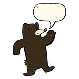 cartoon waving black bear with speech bubble Royalty Free Stock Photo