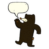 cartoon waving black bear with speech bubble Stock Images