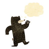cartoon waving black bear with thought bubble Stock Photos