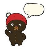 Cartoon waving black teddy bear in winter hat with speech bubble Royalty Free Stock Photos