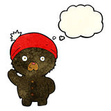 cartoon waving black teddy bear in winter hat with thought bubbl Royalty Free Stock Images