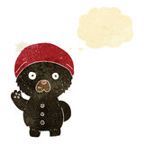 cartoon waving black teddy bear in winter hat with thought bubbl Stock Images