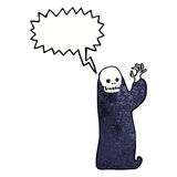 Cartoon waving halloween ghoul with speech bubble Stock Images