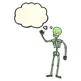 Cartoon waving skeleton with thought bubble Stock Photo