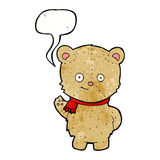 Cartoon waving teddy bear with speech bubble Stock Image