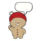 Cartoon waving teddy bear in winter hat with speech bubble Royalty Free Stock Photos