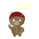 Cartoon waving teddy bear in winter hat with speech bubble Royalty Free Stock Images