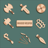 Cartoon weapon set. Cartoon weapon set for mobile rpg game. wooden weapon icons isolated on dark green background royalty free illustration