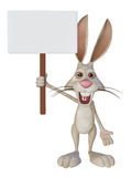 Cartoon white rabbit with a blank sign Royalty Free Stock Images
