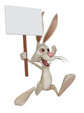Cartoon white rabbit with a blank sign Royalty Free Stock Image