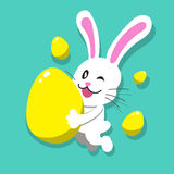 Cartoon white rabbit with easter eggs Stock Photo