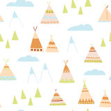 Cartoon wigwams seamless pattern. Native American wigwams, trees mountains clouds Perfect for children`s design Royalty Free Stock Image